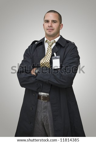 """Quality control officer? FBI man? Bodyguard? Fire Marshall? Take your pick. You can even create your own ID for """"the man""""...just put your own words on his ID badge. - stock photo"""