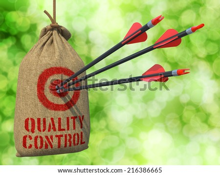 Quality Control - Three Arrows Hit in Red Target on a Hanging Sack on Green Bokeh Background. - stock photo