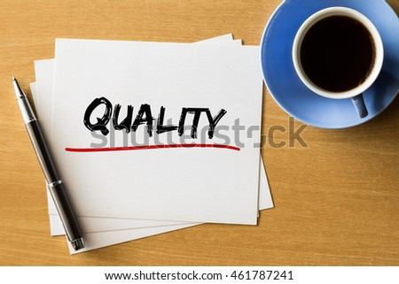 Quality - handwriting on papers with cup of coffee and pen, business concept
