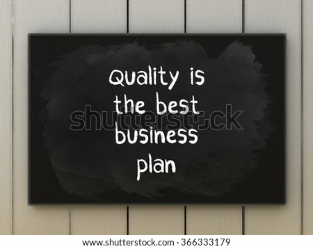 Quality is the best business plan on blackboard written with chalk.  - stock photo