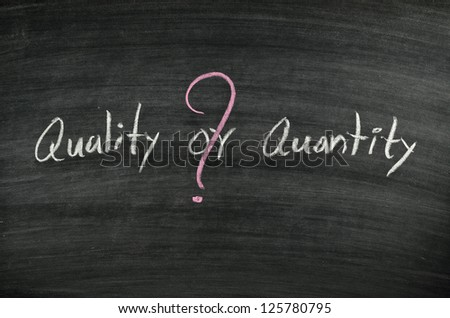 quality or quantity written on blackboard