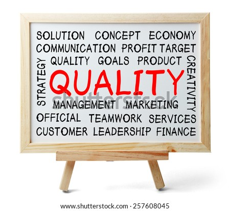 Quality word cloud is written on a whiteboard which is isolated on white background. - stock photo