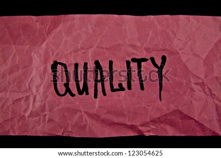 quality word on paper - stock photo