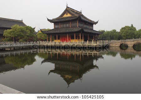Quanfu Temple and Reflection in Pond in Zhouzhuang China - stock photo