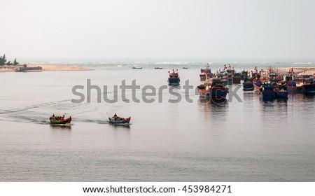 QUANG BINH, Vietnam, July 12, 2016 Fishing boats, estuary Nhat Le, Quang Binh waters, Vietnam