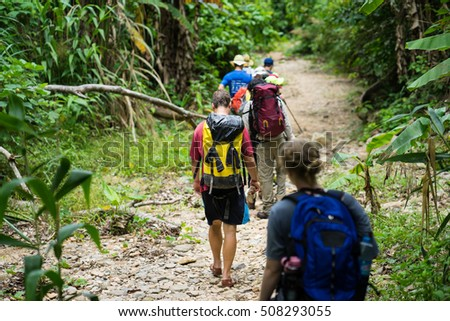 Quang Binh, Vietnam - June 17, 2016: Group of hikers walking on forest heading to Son Doong cave - the largest known cave passage in the world by volume in Quang Binh province, Vietnam