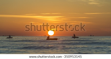 Quang Ngai, Vietnam, June 27th, 2015: Men on boats fishing near the shore in early morning in Quang Ngai, Vietnam