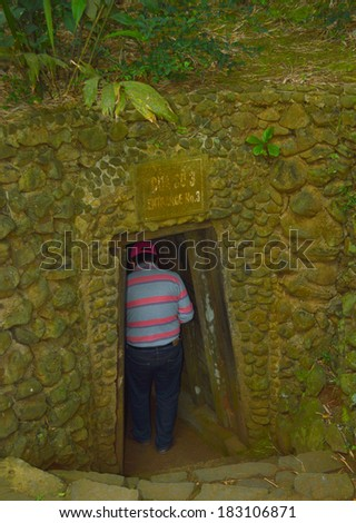 QUANG TRI, VIETNAM - MARCH 13 : Tourist walks into Vinh Moc underground tunnel used during B52 carpet bombing between Vietnam war on March 13, 2014 in Quang Tri, Vietnam.