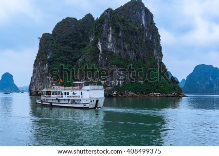 QUANGNINH, VIETNAM, APRIL 02, 2016. Beautiful seascape with tourist boats in Halong bay. Halongbay is World Natural Heritage of Quang Ninh Vietnam.