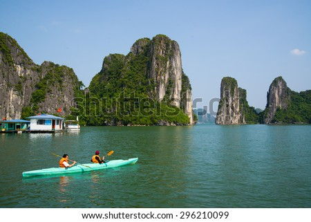 QUANGNINH, VIETNAM, July 12, 2015. Tourists are rowing kayak in Halong bay. Halongbay is World Natural Heritage of Quang Ninh Vietnam.