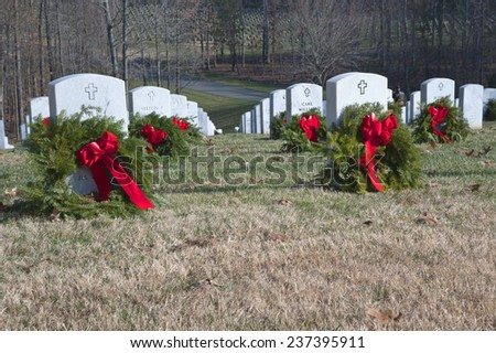 QUANTICO, VA-DEC 13, 2014: Quantico National Cemetery wreath laying event on Dec 13 Wreaths Across America , a non profit organization,  placed wreaths after a brief ceremony.  - stock photo