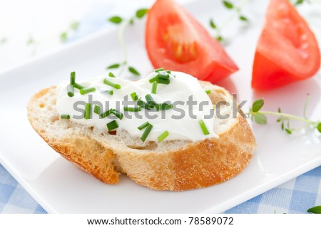 quark with chives on baguette - stock photo