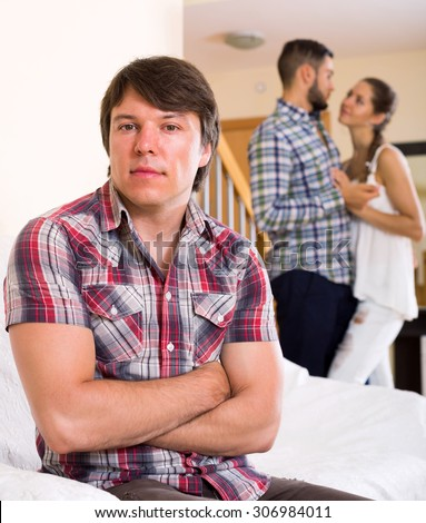 Quarrel among young partners at home interior  - stock photo