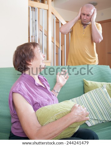 quarrel between an elderly mother and adult son.  - stock photo