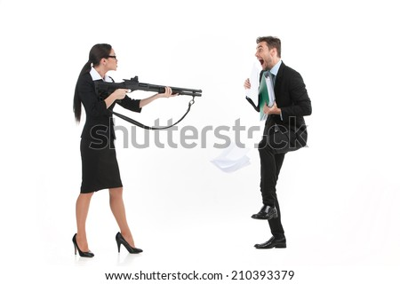 quarrel between man and woman over white background. side view of woman standing and pointing at man with gun - stock photo