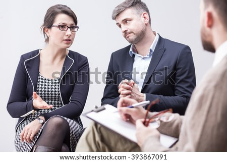 Quarrel in marriage and discussion on couple psychotherapy - stock photo