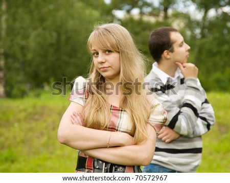 quarrel in the park. Focus on girl only - stock photo
