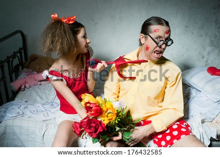 Quarrel of spouses on the bed - stock photo