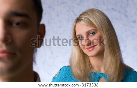 Quarrel of the man and the woman on a blue background - stock photo