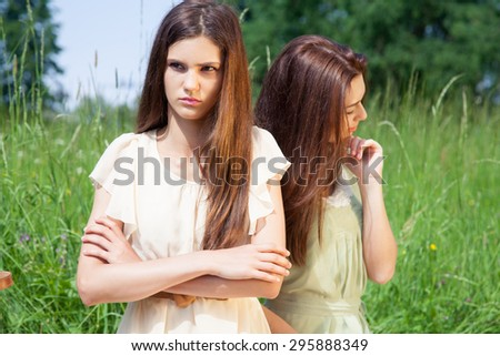 Quarrel of two young women - best friends have a disagreement. - stock photo