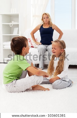 Quarreling and fighting kids with their puzzled mother in background - stock photo