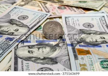 Quarter dollar coin and One  Hundred Dollar banknotes currency of the United States - stock photo