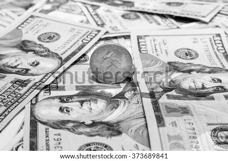 Quarter dollar coin and One  Hundred Dollar banknotes currency of the United States. toned image - stock photo