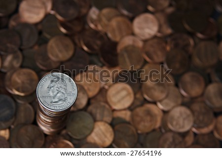quarter on top of a stack of pennies.