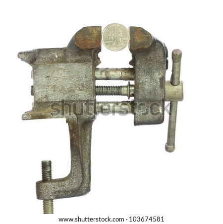 Quarter squeezed tightly in a metal bench vice - stock photo