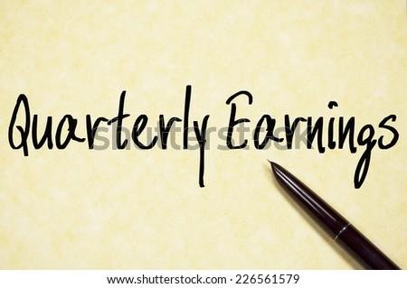 quarterly earnings text write on paper  - stock photo