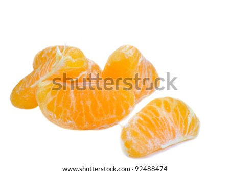 quarters of clementine on white background