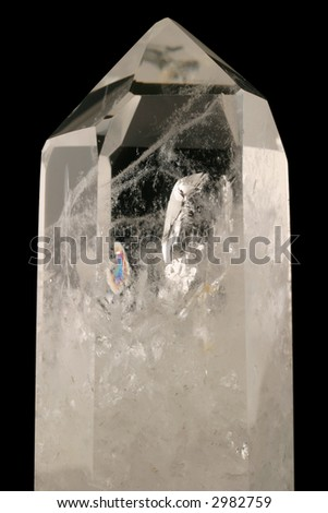 Quartz Crystal. Healing powers in alternative health. Light passes through this strongly bound intricacy structure. Fluid inclusions, trigonal symmetry & crystal faces well developed.  Tectosilicate. - stock photo