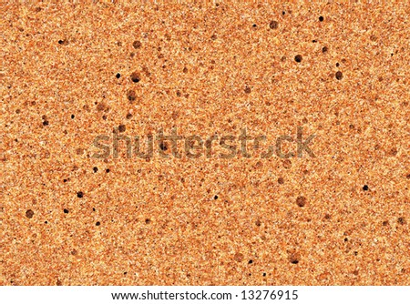 quartz sand on the beach with holes texture background