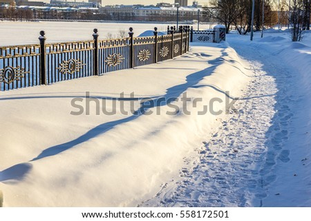 Quay cast iron fence. Contemporary Russia. Winter in the Urals.