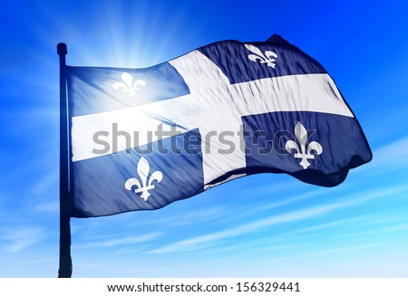 Quebec (Canada) flag waving on the wind - stock photo