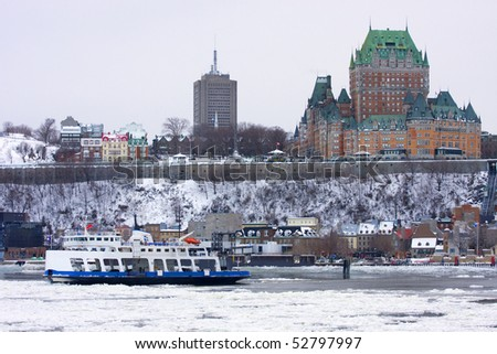 Quebec City and Saint Lawrence River in winter - stock photo