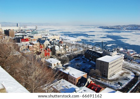 Quebec City and St. Lawrence River in winter - stock photo