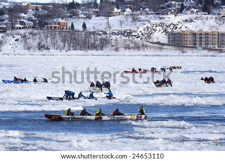QUEBEC CITY, CANADA - FEBRUARY 8. Quebec Carnival 2009: International Ice Canoe Race on St. Lawrence River. Main event of the canival.