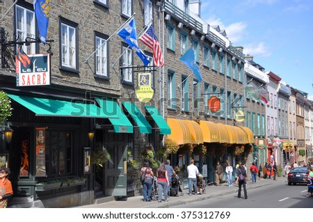 QUEBEC CITY, CANADA - SEP 10: Colorful Houses on Rue Saint Louis (St. Louis Street) on September 10, 2011 in Quebec City, Quebec, Canada. Old Quebec City is UNESCO World Heritage Site since 1985. - stock photo
