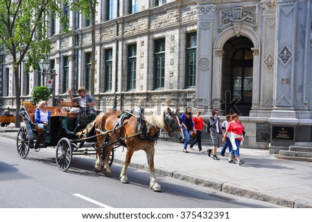 QUEBEC CITY, CANADA - SEP 10: Horse drawn carriage tours on Rue Saint Louis on September 10, 2011 in Quebec City, Quebec, Canada. Historic District of Quebec City is UNESCO World Heritage Site since. - stock photo
