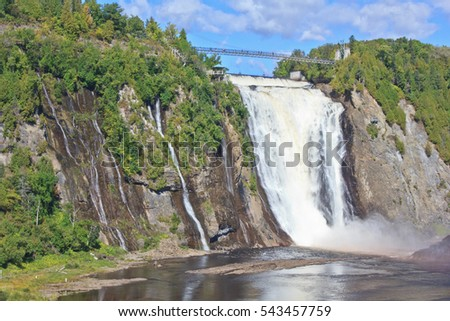 QUEBEC CITY, CANADA - SEPTEMBER 16, 2016: Montmorency Falls form the mouth of the Montmorency River which flows into the Saint Lawrence River near the historic center of Quebec City.