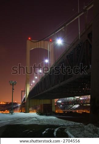 Quebec City's Pierre Laporte Bridge at night in winter - stock photo