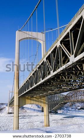 Quebec City's Pierre Laporte Bridge in winter - stock photo