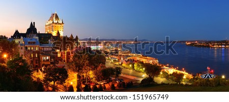 Quebec City skyline panorama with Chateau Frontenac at dusk viewed from hill - stock photo
