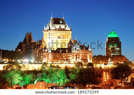 Quebec City skyline with Chateau Frontenac at dusk viewed from hill - stock photo