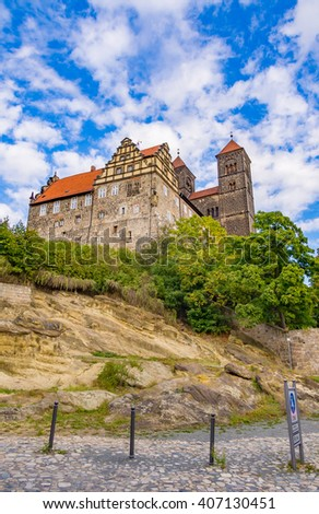 QUEDLINBURG, GERMANY - SEP 19: The Castle Hill in Quedlinburg, Germany on September 19, 2013. Quedlinburg is a medieval German town situated just north of the Harz mountains.