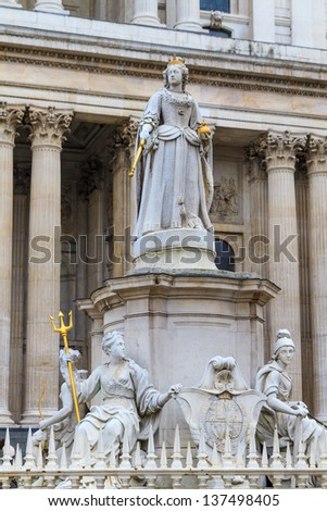 Queen Anne Statue In Front Of St Paul's Cathedral, London, UK - stock photo