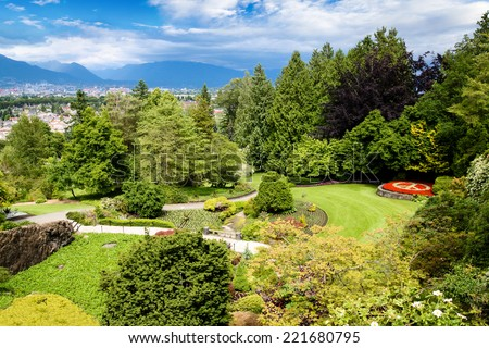 Queen Elizabeth Park in Vancouver. At 152 meters above sea level, the public park is the highest point in Vancouver with spectacular views of the gardens, city and mountains on the North Shore. - stock photo