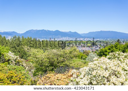 Queen Elizabeth park, Vancouver, Canada with downtown and mountains view. - stock photo
