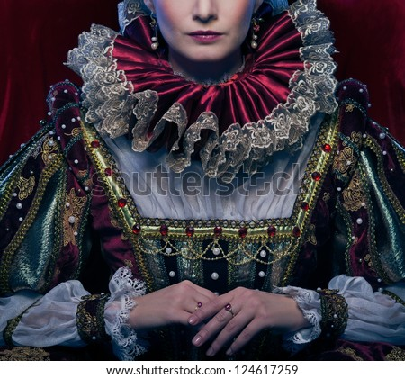 Queen in royal dress and luxuriant collar - stock photo